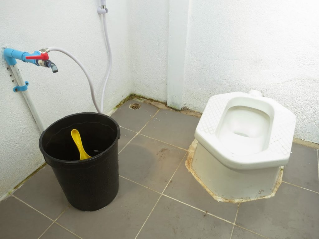 squat toilet with bucket