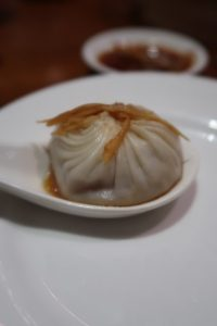 signature dish ziaolongbao at din tai fung served with ginger